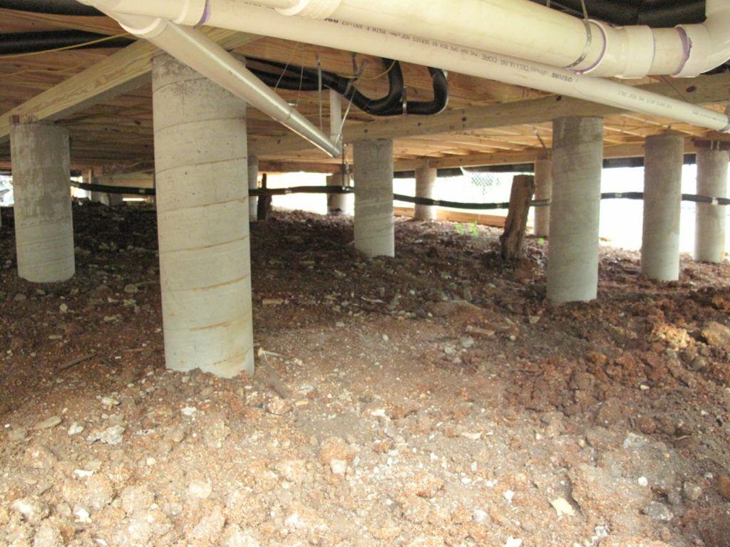Дом на фундаменте из прочных асбестовых труб