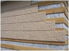 Отделка фундамента начинается с крепежа первой плиты в дальнем внутреннем углу постройки.Наружные углы закрывают специальными уголками, не способными снизить привлекательность облицовки.